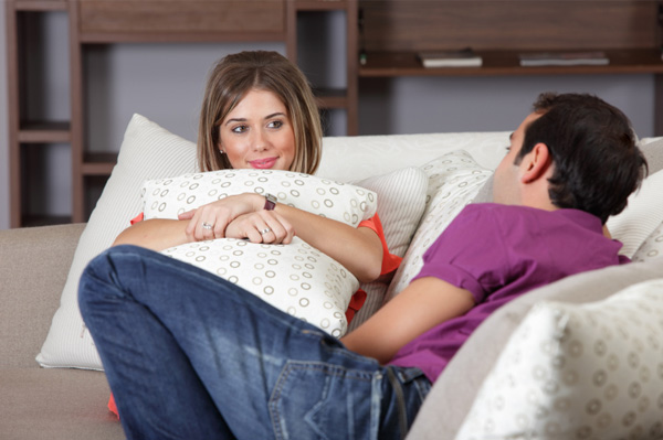 couple-talking-in-living-room
