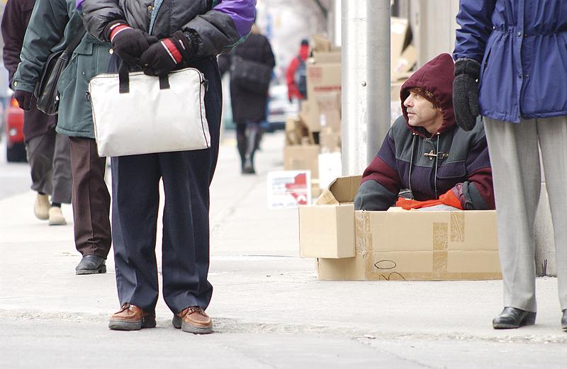 poor-and-needy-man-sitting-on-sidewalk